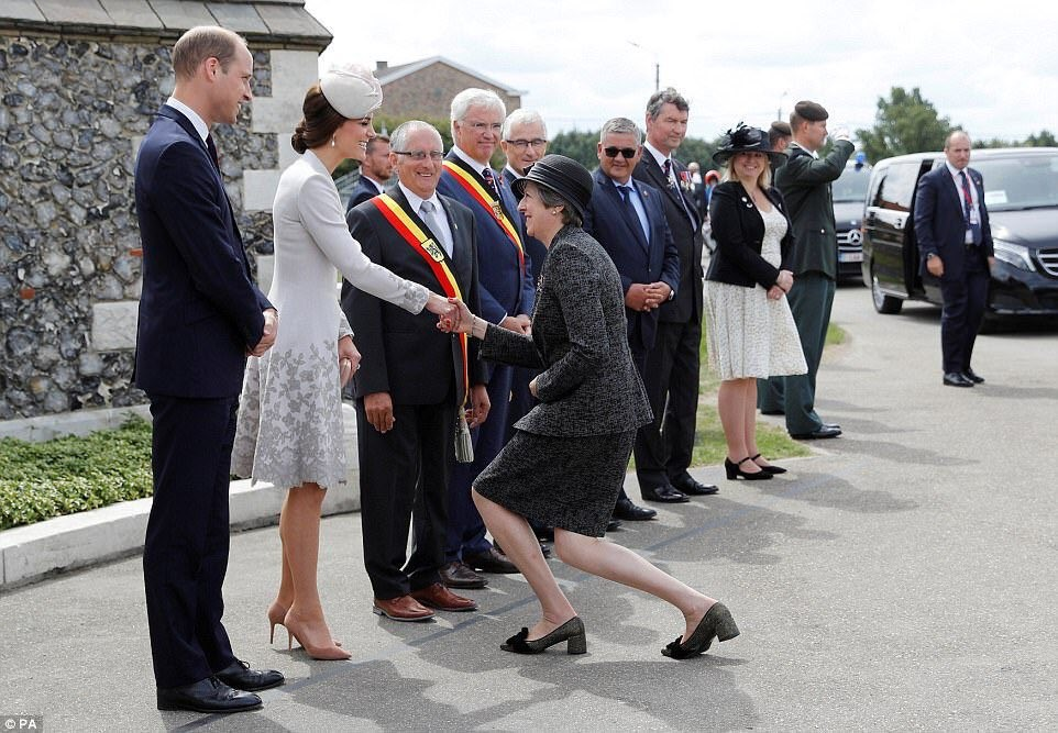 British Prime Minister Therasa May almost kneeling to greet members of the royal family