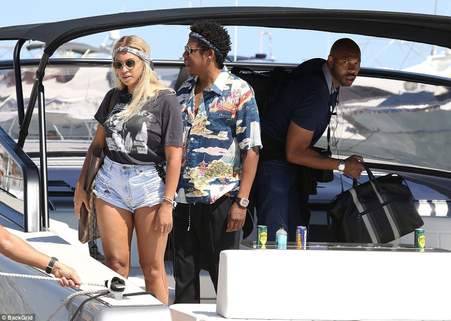 Beyoncé Speculation She's Pregnant With Baby four,conceals her stomach in baggy T-shirt she relaxes on a yacht with Jay-Z