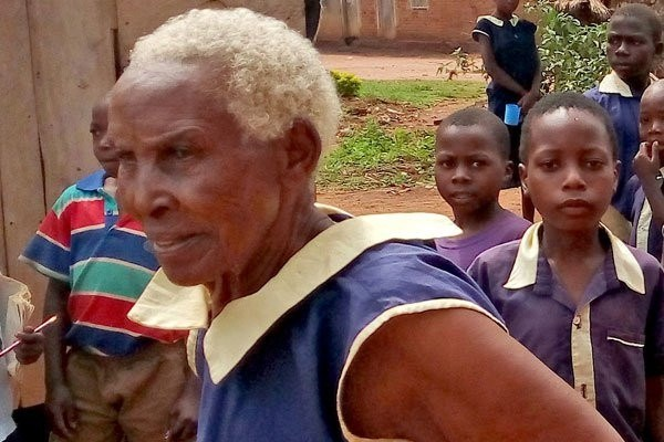 80-year-old woman Ms Maria Obonyo, a farmer in Uganda enrolls for Primary One, aims to become a teacher