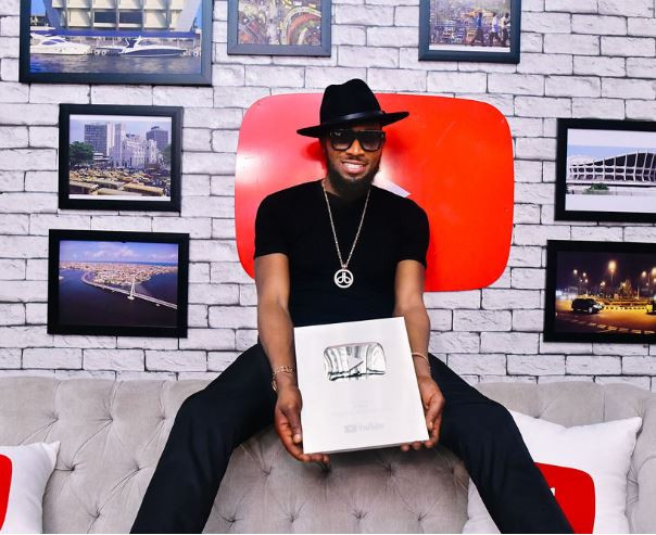 Dbanj receives Silver plaque from YouTube after hitting 100,000 subscribers