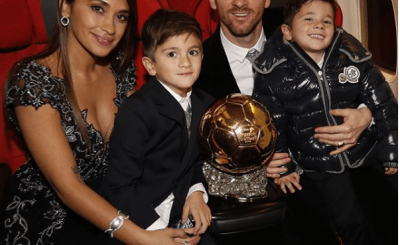 Lionel Messi shows off his 6th Ballon d'Or trophy with family