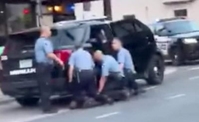 New evident shows that three Minneapolis Police officers kneeling on George Floyd before his death